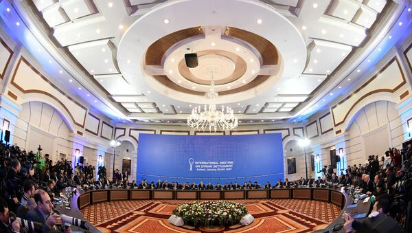 Representatives of the Syria regime and rebel groups along with other attendees take part in the first session of Syria peace talks at Astana's Rixos President Hotel on January 23, 2017. Kirill KUDRYAVTSEV / AFP - Sputnik International