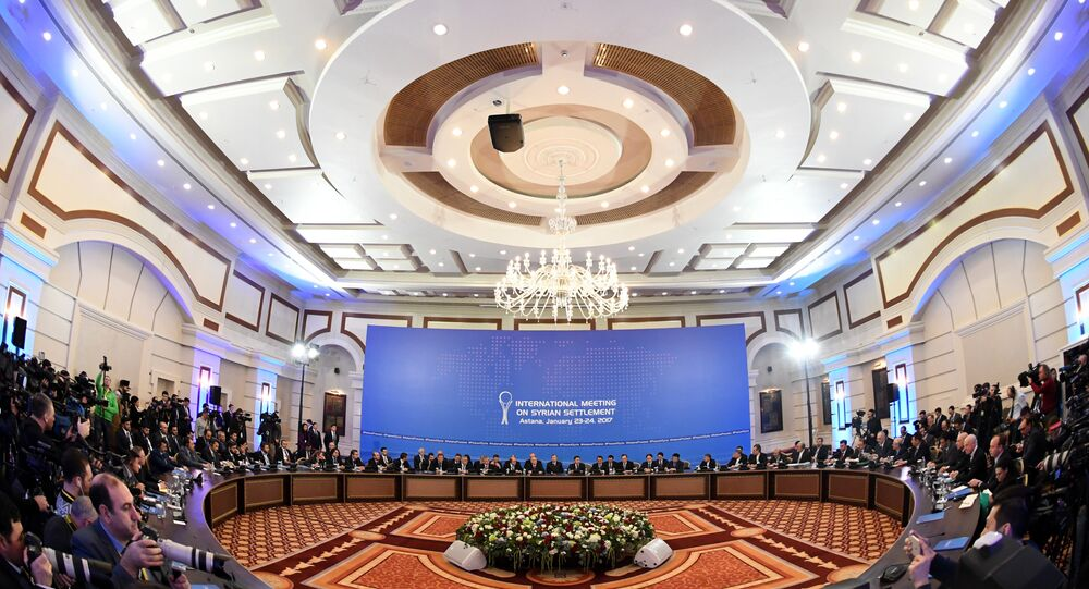 Representatives of the Syria regime and rebel groups along with other attendees take part in the first session of Syria peace talks at Astana's Rixos President Hotel on January 23, 2017. Kirill KUDRYAVTSEV / AFP