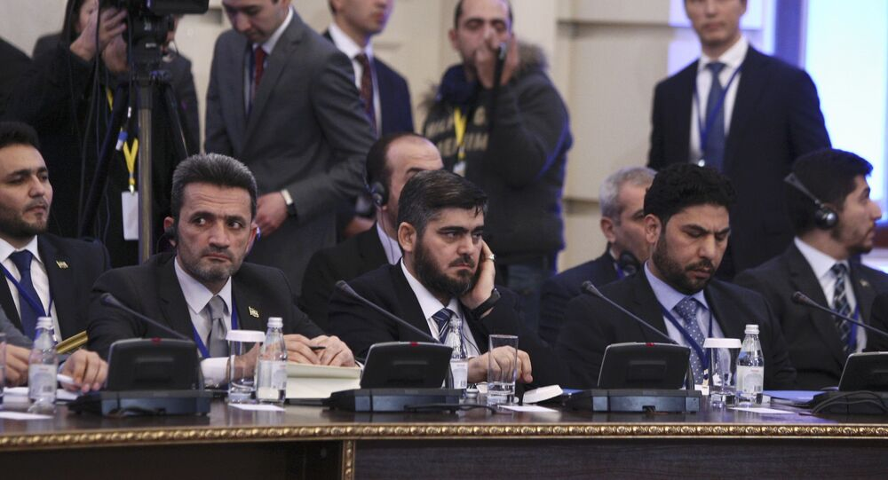 Mohammad Alloush (C), the head of the Syrian opposition delegation, attends Syria peace talks in Astana, Kazakhstan January 23, 2017.