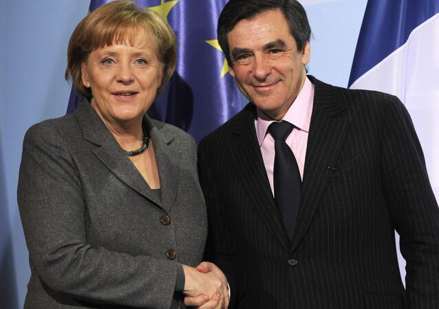 German Chancellor Angela Merkel (L) and French Prime Minister Francois Fillon shake hands after a press conference following talks at the chancellery in Berlin March 10, 2010. T