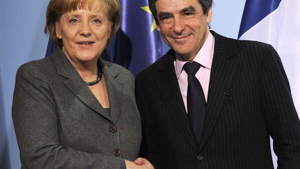 German Chancellor Angela Merkel (L) and French Prime Minister Francois Fillon shake hands after a press conference following talks at the chancellery in Berlin March 10, 2010. T - Sputnik International