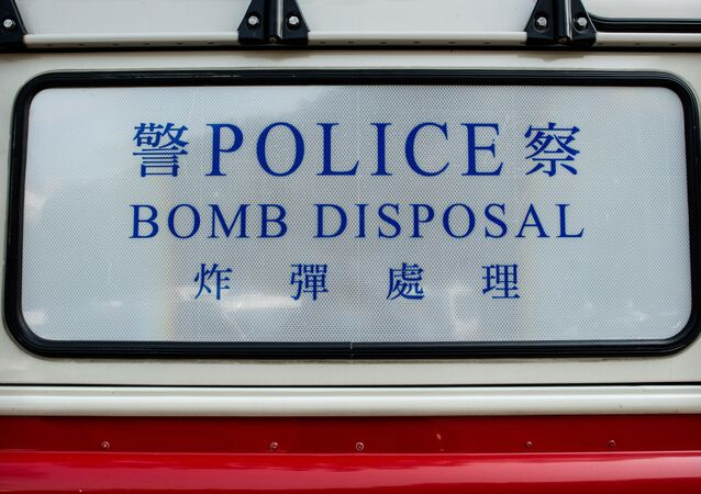 A marking of police bomb squad vehicle is seen in front of a closed road leading to a hiking trail after a World War II-era artillery shell was found by a hiker in Hong Kong (file)