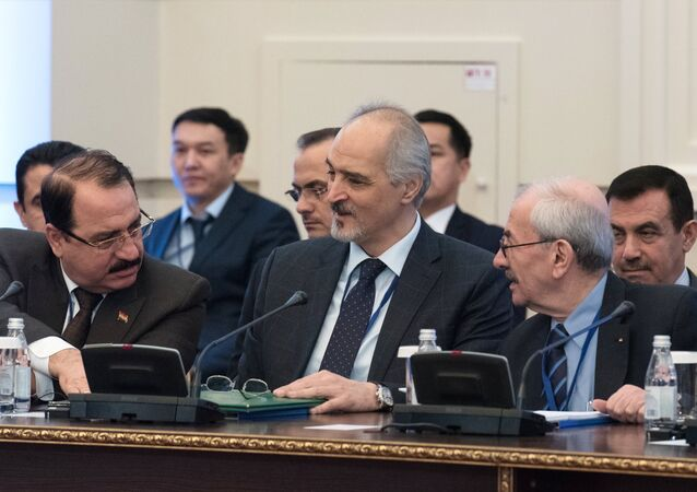 Bashar Jaafari, center, Permanent Representative of the Syrian Arab Republic to the United Nations and head of the Syrian government delegation, at a meeting on Syria in Astana.