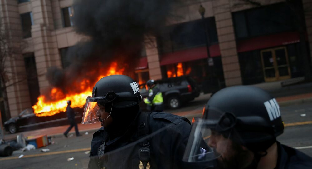 Limousine set on fire by protesters during 2017 inauguration in Washington, DC.