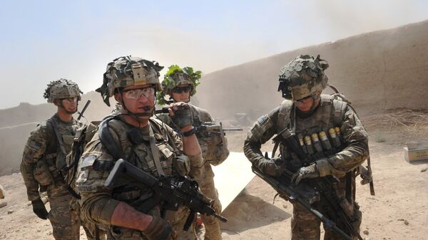 In this photo taken on 5 August 2011, US troops from the Charlie Company, 2-87 Infantry, 3d Brigade Combat Team under Afghanistan's International Security Assistance Force patrols Kandalay village following Taliban attacks on a joint US and Afghan National Army checkpoint protecting the western area of Kandalay village. - Sputnik International