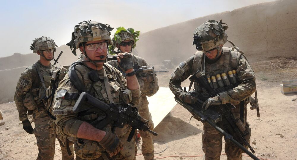In this photo taken on 5 August 2011, US troops from the Charlie Company, 2-87 Infantry, 3d Brigade Combat Team under Afghanistan's International Security Assistance Force patrols Kandalay village following Taliban attacks on a joint US and Afghan National Army checkpoint protecting the western area of Kandalay village.
