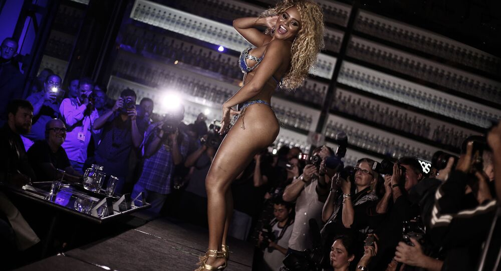 Erika Canela from Bahia smiles after winning the Miss Bumbum Brazil 2015 pageant in Sao Paulo, Brazil on November 9, 2016.