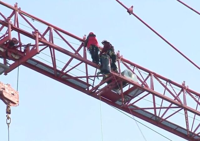 Protesters climb crane in northwest DC from the White House
