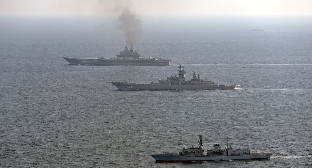 HMS St Albans (front) monitors Russian warships Pyotr Velikiy and the Admiral Kuznetsov (rear) as they pass close to UK territorial waters