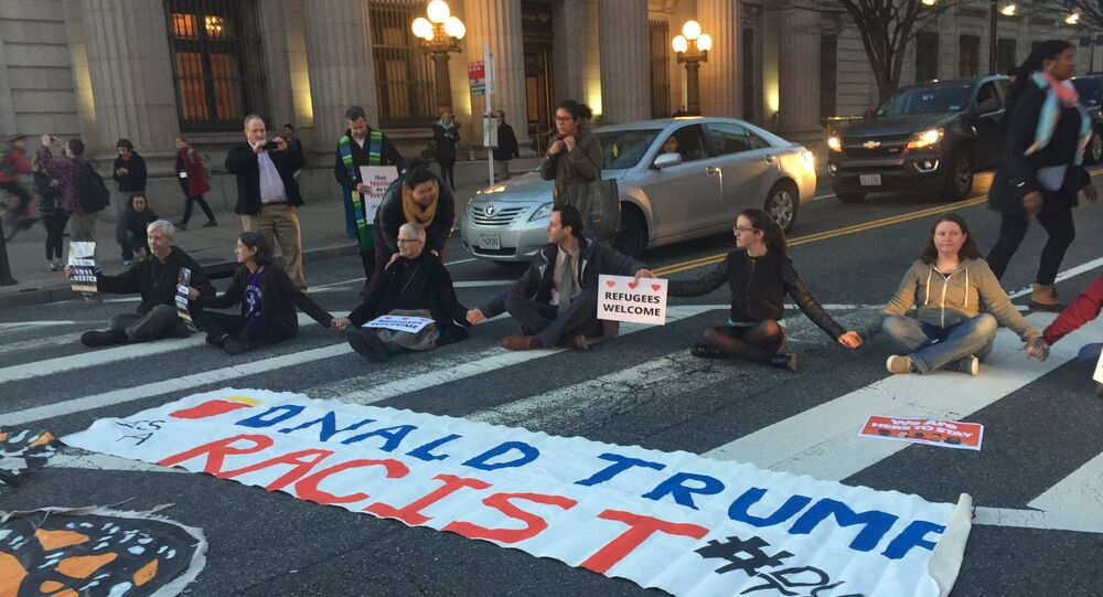 President Donald Trump's latest batch of executive actions drew protesters and activists to the streets surrounding the White House.