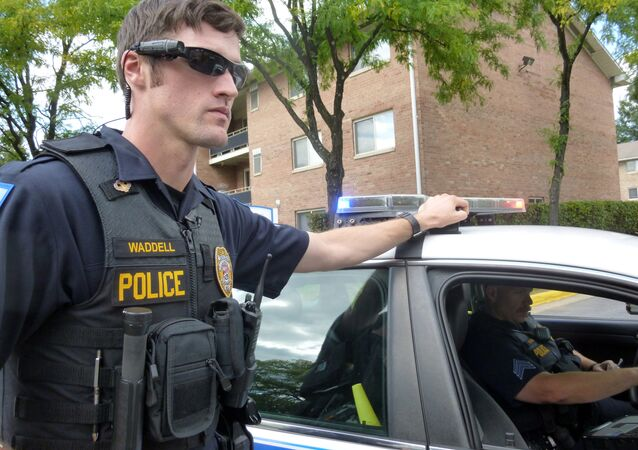 Laurel, Maryland, Police Officer Aaron Waddell shows on September 17, 2014, how the Laurel Police Department has been using body-cameras during patrols.