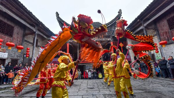 Locals perform a dragon dance during a celebration event ahead of China's Spring Festival, in Chenzhou, Hunan province, China, January 21, 2017. Picture taken January 21, 2017 - Sputnik International