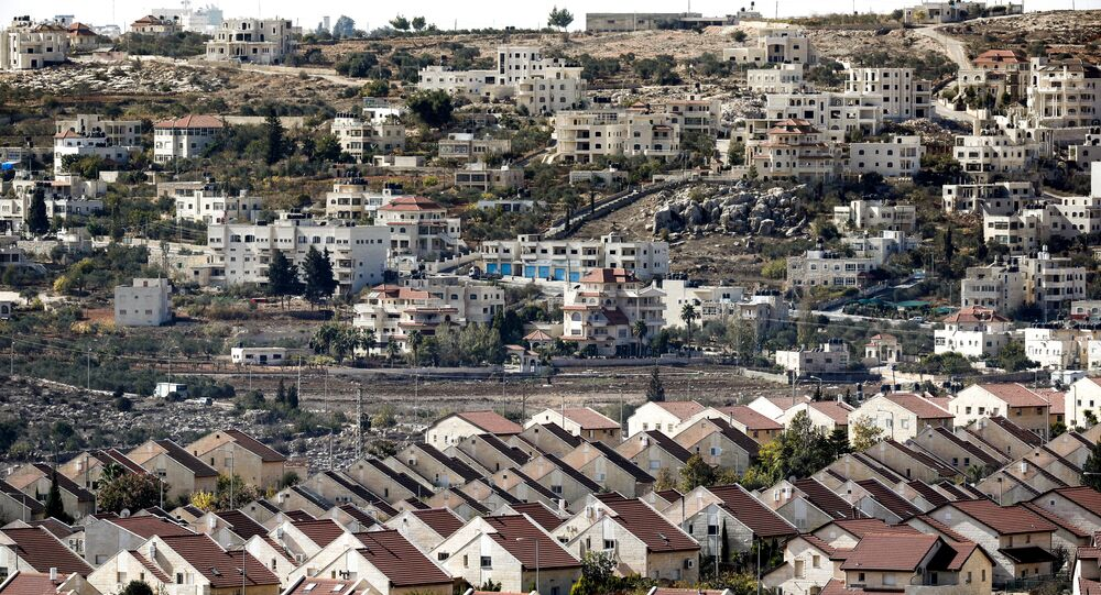 A picture taken on November 17, 2016 shows a general view of houses in the settlement of Ofra in the Israeli-occupied West Bank, established in the vicinity of the Palestinian village of Baytin (background)
