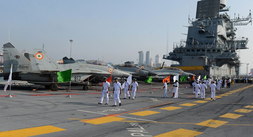 Naval personnel walk along India's largest naval ship the INS Vikramaditya as she anchors in the Sri Lankan capital Colombo on January 21, 2016