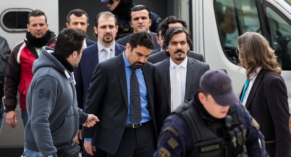 The eight Turkish soldiers, who fled to Greece in a helicopter and requested political asylum after a failed military coup against the government, are escorted by police officers as they arrive at the Supreme Court in Athens, Greece, January 26, 2017