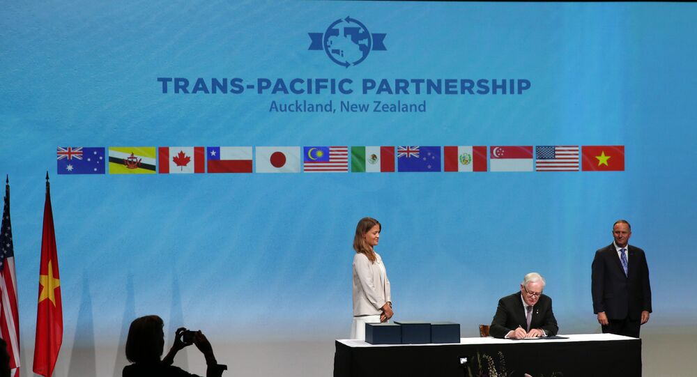 Andrew Robb (C) the Minister for Trade and Investment from Australia watched by New Zealand Prime Minister John Key as he and the Ministerial Representatives from the 12 countries arrive to sign the Trans-Pacific Partnership agreement in Auckland on February 4, 2016