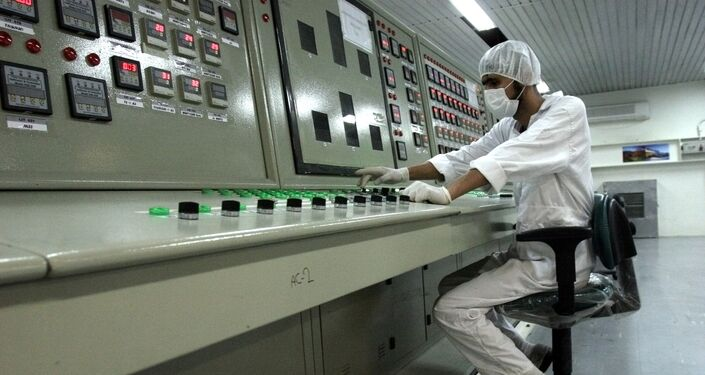 In this Saturday, Feb. 3, 2007 file photo, an Iranian technician works at the Uranium Conversion Facility just outside the city of Isfahan 255 miles (410 kilometers) south of the capital Tehran, Iran