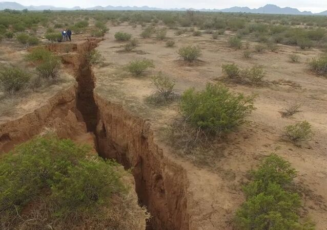 A 1.8 mile long fissure discovered in the Arizona desert. Experts call it a danger to unaware ATV riders and livestock.