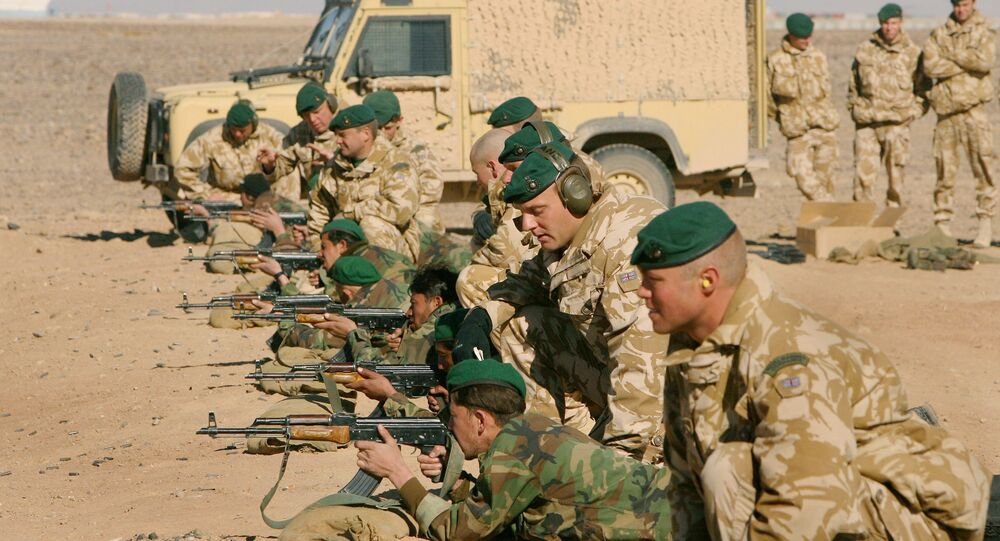 British Army officers from Operational Mentoring Liaison Training (OMLT) company train Afghan National Army or ANA, soldiers in firearms, near Camp Bastion, southern Afghanistan, Tuesday, Jan. 16, 2007.