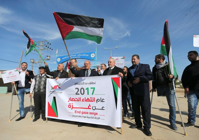 Palestinians take part in a protest against the Gaza blockade, near Israeli Erez crossing in the northern Gaza Strip January 5, 2017