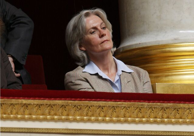 Penelope Fillon, France's Prime Minister Francois Fillon's wife, listens as her husband delivers a speech in front of the newly elected National Assembly outlining his government's priorities in Paris, France, July 3, 2007