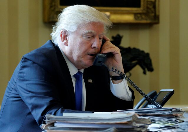 U.S. President Donald Trump speaks by phone with Russia's President Vladimir Putin in the Oval Office at the White House in Washington, U.S. January 28, 2017