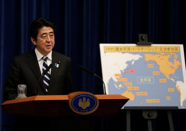 Japan's Prime Minister Shinzo Abe speaks next to a map showing participating countries in rule-making negotiations for the Trans-Pacific Partnership (TPP) during a news conference at his official residence in Tokyo (File)