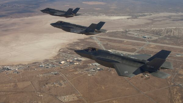 Three F-35 Joint Strike Fighters, (rear to front) AF-2, AF-3 and AF-4, flies over Edwards Air Force Base in this December 10, 2011 handout photo provided by Lockheed Martin - Sputnik International