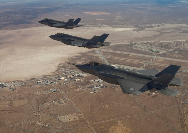 Three F-35 Joint Strike Fighters, (rear to front) AF-2, AF-3 and AF-4, flies over Edwards Air Force Base in this December 10, 2011 handout photo provided by Lockheed Martin