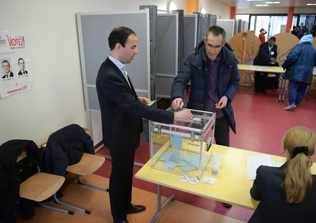 A man casts his ballot in the second round of the left-wing primary for the 2017 French presidential election in Trappes on January 29, 2017