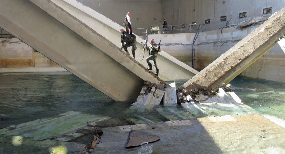 Pro-Syrian regime fighters are seen at the Ain al-Fijeh water pumping station, in the countryside of Damascus, on January 29, 2017