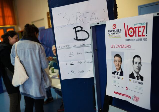 The pictures of candidates Manuel Valls and Benoit Hamon at a polling station in Paris during the second round of Socialist party primaries.