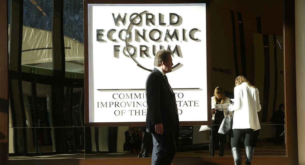 An attendee arrives in the Congress Hall during the World Economic Forum (WEF) annual meeting in Davos, Switzerland January 20, 2017