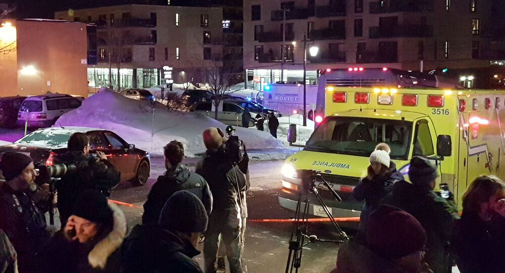 An ambulance is parked at the scene of a fatal shooting at the Quebec Islamic Cultural Centre in Quebec City, Canada January 29, 2017