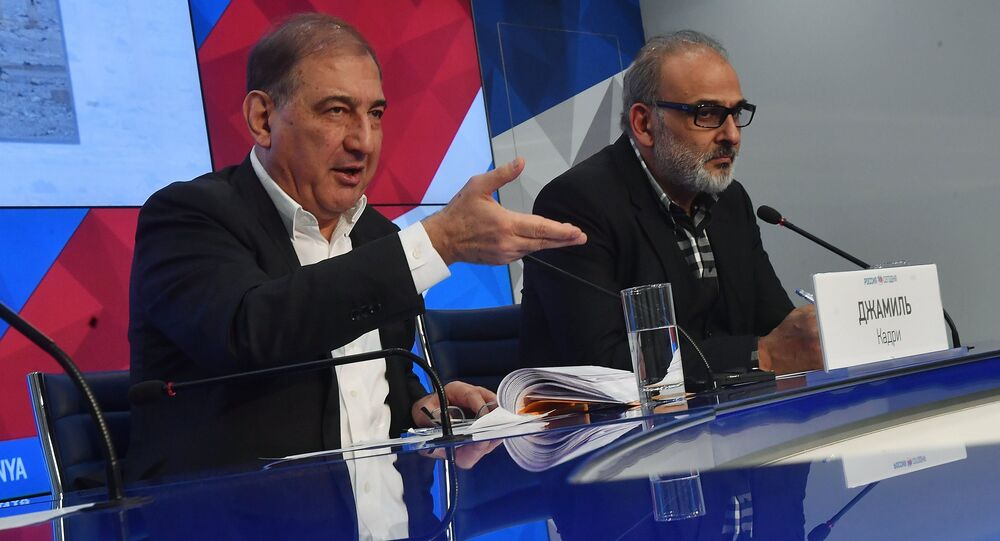 Qadri Jamil, left, chairman of the Syrian opposition's Moscow group, secretary of the People's Will Party and one of the leaders of the Popular Front for Change and Liberation, with Jamal Suleiman, a representative of the Syrian opposition's Cairo group, during a news conference at the Rossiya Segodnya International Multimedia Press Center in Moscow