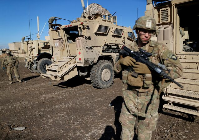US. army soldiers stand next a military vehicle in the town of Bartella, east of Mosul, Iraq, December 27, 2016