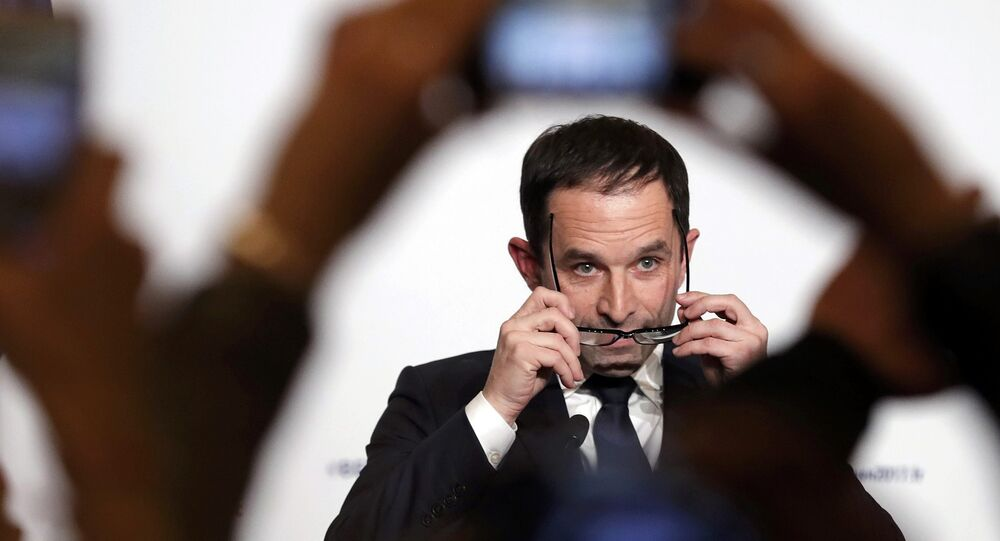 Former French education minister Benoit Hamon reacts after partial results in the second round of the French left's presidential primary election in Paris, France, January 29, 2017.