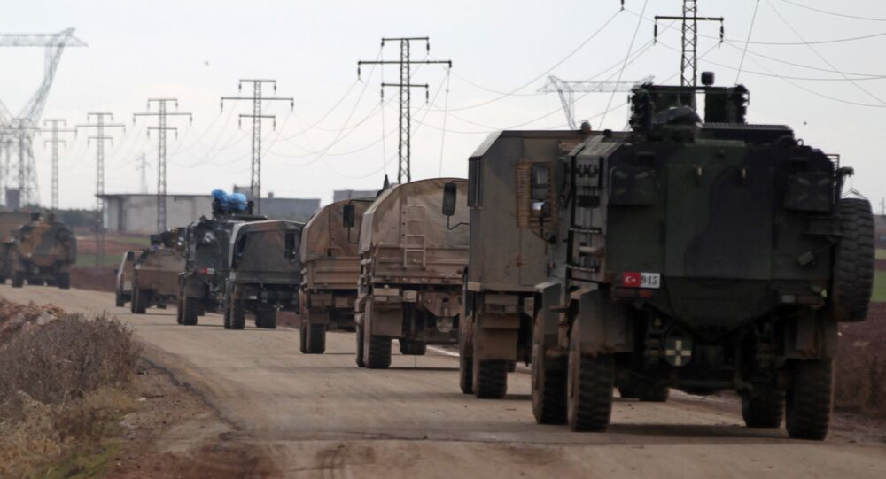 Turkish military vehicles drive in the Syrian rebel-held town of al-Rai, as they head towards the northern Syrian town of al-Bab, Syria January 9, 2017