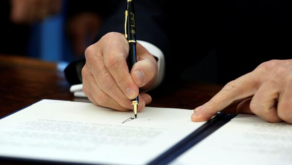 U.S. President Donald Trump signs a memorandum to security services directing them to defeat the Islamic State in the Oval Office at the White House in Washington, U.S. January 28, 2017 - Sputnik International