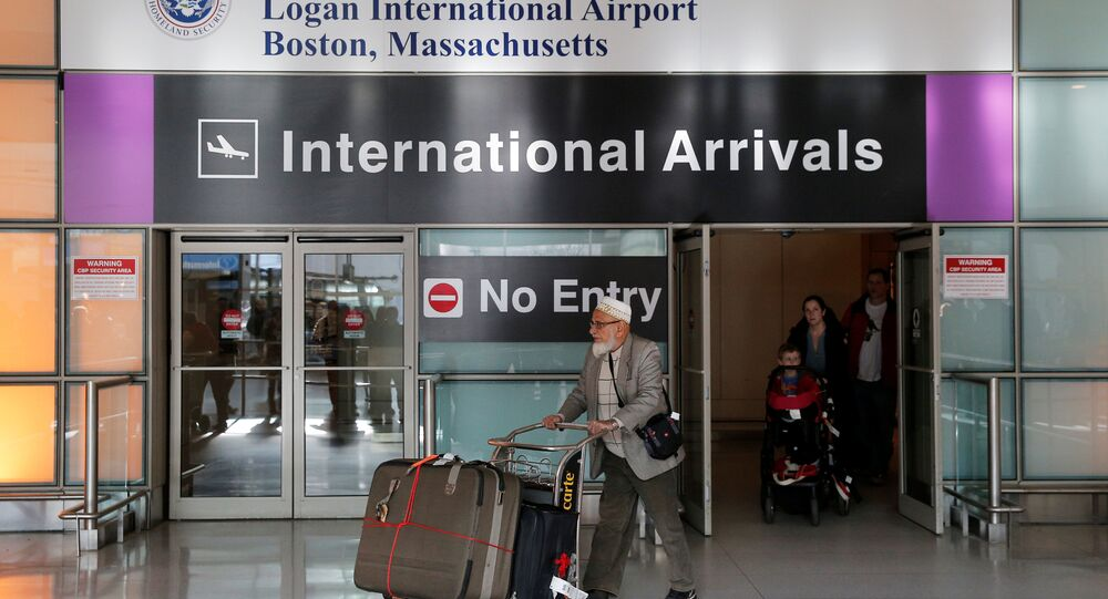 International travelers arrive after US President Donald Trump's executive order travel ban at Logan Airport in Boston, Massachusetts, U.S