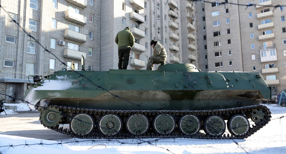 Ukrainian medical servicemen stand on an Armoured Personnel Carriers (APC) after they carried wounded servicemen to hospital in Ukraine-controlled town of Avdiivka, in Donetsk region
