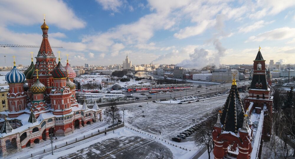 The St. Basil's Cathedral and Vasilyevsky Spusk Square as seen from the Spasskaya Tower of the Moscow Kremlin. Right: the Tsarskaya and Nabatnaya towers.