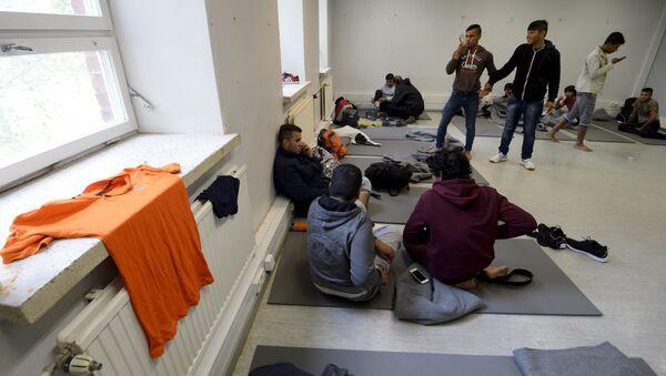 Iraqi migrants are pictured inside a refugee center located in former barracks, in Lahti, Finland - Sputnik International