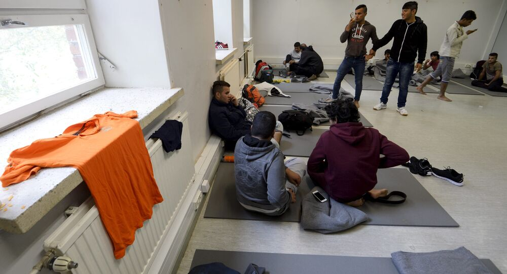 Iraqi migrants are pictured inside a refugee center located in former barracks, in Lahti, Finland