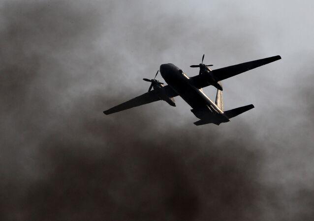 A Ukrainian military transport plane came under fire on Wednesday while conducting a training flight over the Black Sea, Ukrainian Defense Minister Stepan Poltorak said