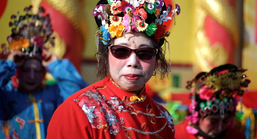 A folk artist waits to perform for a temple fair at Badachu park as the Chinese Lunar New Year, which welcomes the Year of the Rooster, is celebrated in Beijing, China, January 31, 2017.