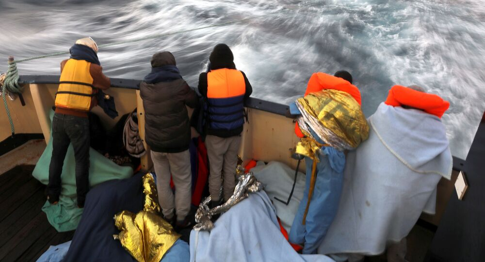 Migrants are seen at the stern of the former fishing trawler Golfo Azzurro of the Spanish NGO Proactiva Open Arms, a day after they were rescued along with other migrants near the coasts of Libya, in the central Mediterranean Sea, January 28, 2017.