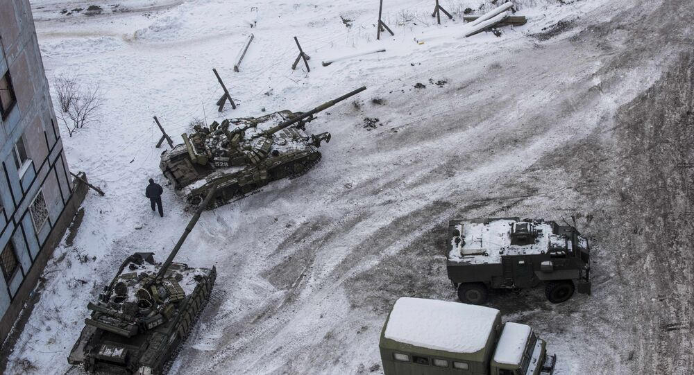 Ukrainian tanks stand in the yard of an apartment block in Avdiivka, eastern Ukraine. Fighting in the area around the town between Kiev forces and local militia escalated last week.