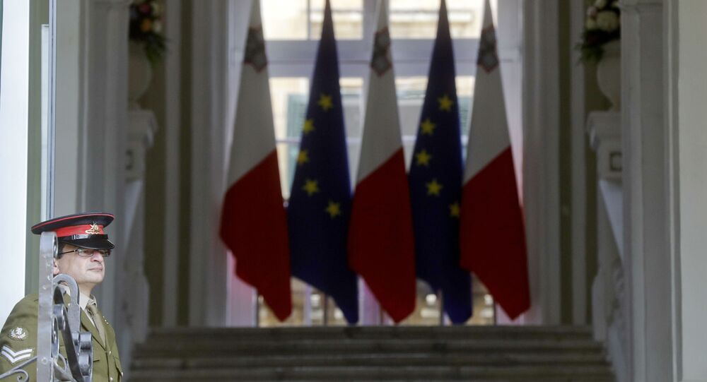 A Maltese army soldier stands in front of the main gate of the the Auberge de Castille palace, Premier's office, on the eve of an EU Summit, in Valletta, Malta