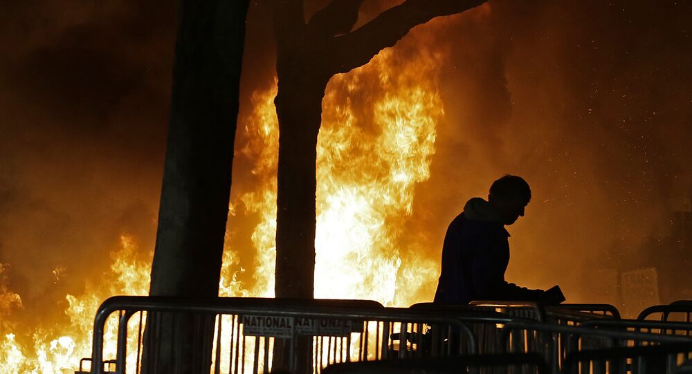 A bonfire set by demonstrators protesting a scheduled speaking appearance by Breitbart News editor Milo Yiannopoulos burns on Sproul Plaza on the University of California at Berkeley campus on Wednesday, Feb. 1, 2017, in Berkeley, Calif.